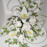 Bridal Flower Spray Bridal spray of roses, freesia and lillies made from porcelain paste.
