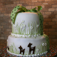 Willow Baby Shower Cake This cake was designed to match the baby-to-be's nursery. Fondant with brown fondant animals, buttercream details, and a ribbon (...