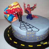 "John Louis' Spidycake My version of the Spiderman cake. Cake for a 4 year old. He was so excited to see a ""SpidyCake"".Fondant for buildings and road..."