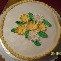 Yellow Daisies Class practice cake. White buttercream with yellow borders. The cake was yellow and had lemon filling. Family liked the combination of...