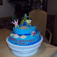 Sponge Bob This is a cake I made for my neices baby who turned 2 butter cream and fondant Gary and pinapple house
