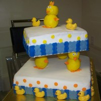 Duck Cake I made for my son's baby shower. The cake were chocolate, Vanilla,banana, strawberry with strawberry & chocolate fillingsThis cake...