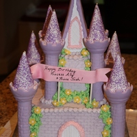 "Lavendar Castle A small lavendar castle for a 5-year-old princess! This was an 8"" with a 4"" on top."