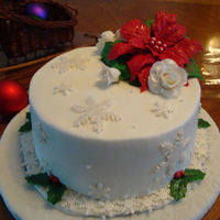 Christmas Course 4 Cake First time Gumpaste pointsettia, holly leaves and snowflakes with fondant snowflake overlays.