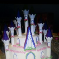 Castle Cake This is a cake made with the Wilton castle kit for my daughter's 4th birthday party. The cake fell apart because the towers are not...