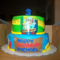 "Handy Manny Cake   10"" and 8 "" white cake with pineapple and strawberry filling , bc with fondant accents... edible sheet for pic"