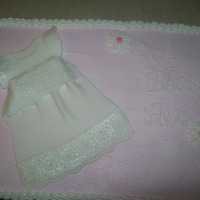 Baby Dedication Cake   11/16 strawberry cake with BC and fondant daisies and letters and fondant dress