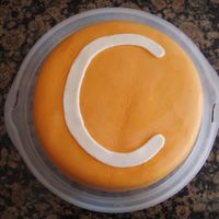 "My Son's 3Rd Birthday Cake My son wanted an orange ""MM' cake for his birthday. This is my first time working with fondant. The cake is a dairy free version..."