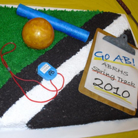 "Track Banquet Cake This cake is a ""slice"" of the track ;-) The black track portion was made with crushed Oreo cookies. The white track line was made..."