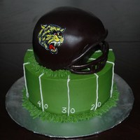 "Football Cake Quick football theme cake. Helmet is made our of two 6"" and carved, face mask is made with gumpaste."