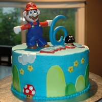 Mario Small Mario cake with cupcakes. All edible as it was for a child. Gumpaste figurines & number and use chocolate for his name.