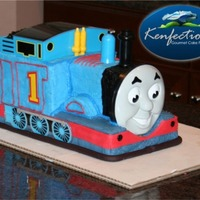Thomas The Tank Cake  This Thomas the Tank semi-custom cake was a hit for a couple of twin boys and their birthday party in Charlotte NC. There are a couple of...