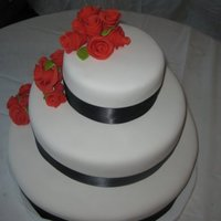 My First Wedding Cake French Vanilla WASC with vanilla buttercream, MMF, gumpaste roses and leaves with ruby pearl dust, black satin ribbon.