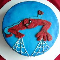 Spiderman   vanilla cake, filled with dulce de leche. Spiderman in fondant... design from somewere on the web that the client gave me.
