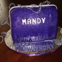 Sparkling And Purple Purse This was made using the Wilton book pan, cutting it in half and standing it up. The Birthday girl wanted a sparkle and purple cake - she...