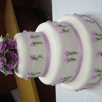 Simple Lavender Just a simple three tier cake with live flowers on the top. This was my first fondant cake that I did - my sister's wedding so she...