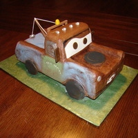 Tow Mater Pound cake decorated with chocolate buttercream with fondant accents and dusted. Not sure I would do the buttercream again and it was a...