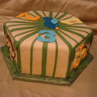 Jungle 1 2 3 The shower cake matched the baby's nursery theme. Chose the hexagon shape to showcase the animals.