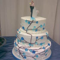 Blue Blossom Cake  For a co-worker's wedding. She wanted cherry blossom's, but in blue. My first (and last!) wedding cake. Among other things, it...