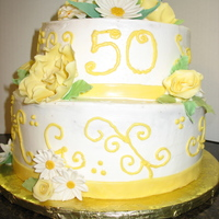 "50Th Anniversary Cake This cake was 2 tier (8"", 10""). BC with fondant/gumpast ribbon accent and flowers. This order was placed 1 week before she wanted..."