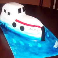 Boat Boat cake with a shark in the water.