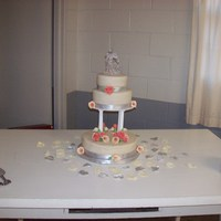 Calla Lilies And Roses 3 tier cake- roses are coral colored and painted with a silver and pink blend of shimmer dustCalla lilies are ivory with the edges dusted a...