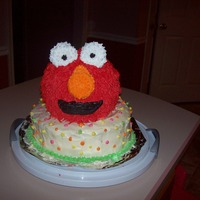 3D Elmo This was my first cake, other than classes, after classes! The whole reason I began classes was to be able to make my daughters 2nd...