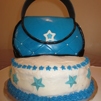 Purse Cake Purse is cake covered with fondant.