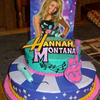 Olivia's 7Th B-Day Hannah Montana Cake White cake with Danish raspberry filling. Gumpaste and MMF accents