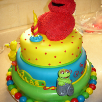 Sesame Street Very fun to make. Elmo is RKT and Big Bird and Oscar are gumpaste. Covered in MMF.