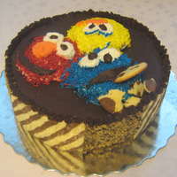 Sesame Street  Elmo & co. for a one-year old. The mom wanted no fondant, no gumpaste and as less coloring as possible. The characters are whipped...