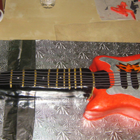 Guitar Hero Chocolate cake and chocolate ganache in the body, same cake with citrus-mascarpone cream in the neck. Homemade MMF fondant.
