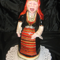 Singer Made the grandma for the bake sale in our Bulgarian orthodox church :). Three tiny tiers of cake :), fondant skirts and scarf, fondant+...