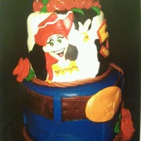 Toy Story's Jessy Cake   Sorry hope the pic is alright the hat is gumpaste everything else fondant!