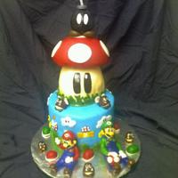 Super Mario Bros Cake   Fondant finish and details. Th bomb it styrafoam