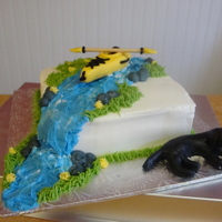 Kayak Birthday Cake made for a client who's dad's two fav things are his yellow kayak and his black lab! White cake, filled with scratch strawberry...