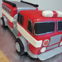 Fire Truck Cake a welcome home cake for a friend who recently became a firefighter!Made from enhanced yellow cake mix, iced/filled in a fudge recipe I came...