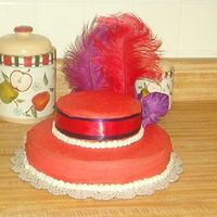 Red Hat Cake  This is a Red Hat cake I did for my MIL. I posted the practice cakethe other day. This turned out a little better. Still can not get the a...