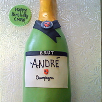 Andre Chmapagne Bottle Customer order for a birthday party. Italian Cream cake with cream cheese frosting, covered in fondant.