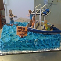 Speedboat Wakeboarding Cake Birthday cake with the birthday boy wakeboarding and his friends on board having a good time. Chocolate cake with vanilla buttercream and...