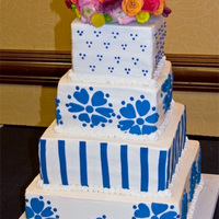 Invitation Wedding Cake This cake was for a friend's wedding. Their invitations had the blue flowers on them and they really wanted them on the cake as well....