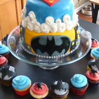 Batman And Superman My son wanted a superhero cake. Since his name is Garrett, I swapped the S in Superman for a G, and created a new logo for the top layer....