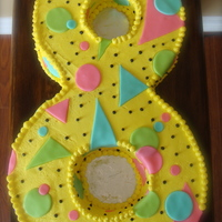 Totally 80's Inspired 8 Cake An 8 year old girl wanted an eighties inspired number 8 for her cake! Buttercream icing tinted in yellow and fondant circles and triangles...