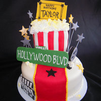 Red Carpet Cake This cake was designed and decorated for a 10 year old girl celebrating her birthday Hollywood style! Covered in fondant...the popcorn box...