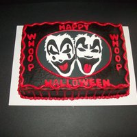 Insane Clown Posse Cake Faces made from fondant and the black was filled in with royal icing.