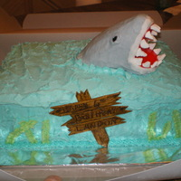 Shark Cake Chocolate cake, buttercream icing, rice crispy shark covered with icing, gumpaste wooden sign