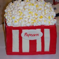 "Popcorn Bucket Birthday Cake this is my mother in law's birthday cake...it is decorated with white buttercream and red fondant. ""popcorn"" is marshmallows..."
