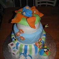 Baby  cake that i made for one of my friend can be use for shower are baptism. The cake toppers the shoes, bee and flower are gum paste and cake...