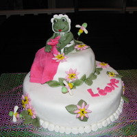Baby Frog   Vanilla cake with buttercreme icing convered with mmf fondant. Frog and others thing are gumpaste