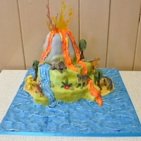 Dinosaur Island I loved making this cake although I felt I cheated a bit with the toys dinosaurs.